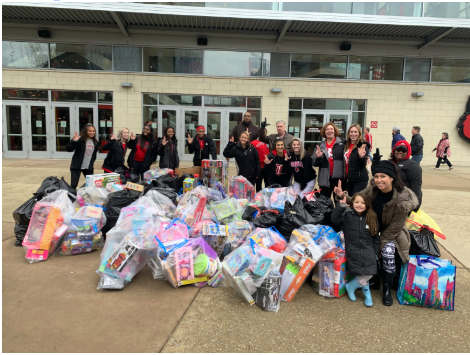 Cheer and Soccer teams collecting toys children. University of Louisvile, Kyle's Korner for Kids